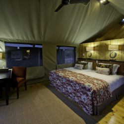 Banoka Bush Camp bedroom interior by Dana Allen